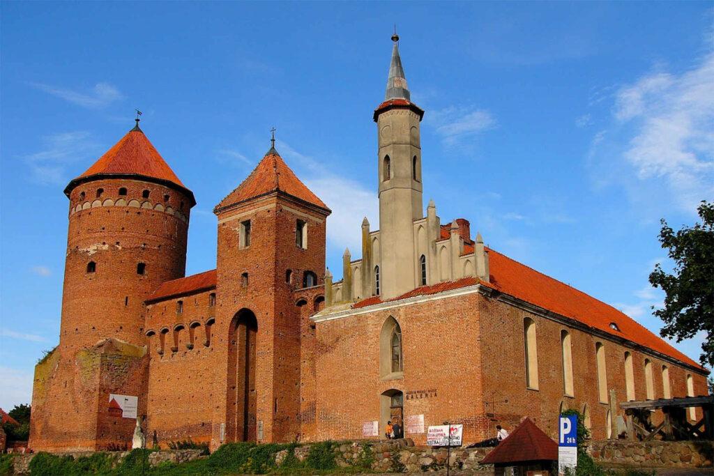 Zu sehen ist die Ordensburg mit Kirche in Rössel, Bild: Gliwi